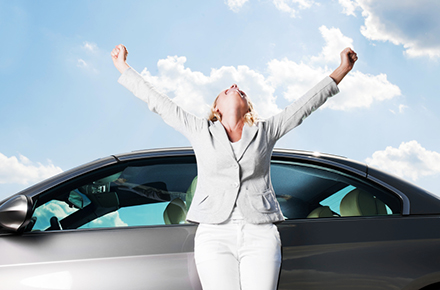 Photo of woman celebrating with new car